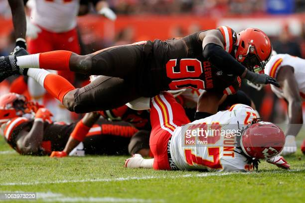 Emmanuel Ogbah of the Cleveland Browns tackles Kareem Hunt of the Kansas City Chiefs during the game at FirstEnergy Stadium on November 4, 2018 in...