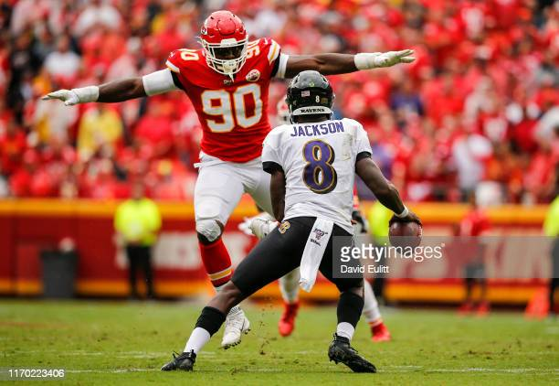 Emmanuel Ogbah of the Kansas City Chiefs blocks the view of Lamar Jackson of the Baltimore Ravens in the third quarter at Arrowhead Stadium on...