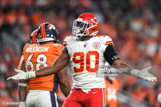 Emmanuel Ogbah of the Kansas City Chiefs celebrates after blocking a pass attempt against the Denver Broncos in the third quarter at Empower Field at...