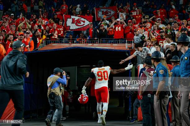 Emmanuel Ogbah of the Kansas City Chiefs is cheered as he runs off the field after a 30-6 win over the Denver Broncos at Empower Field at Mile High...
