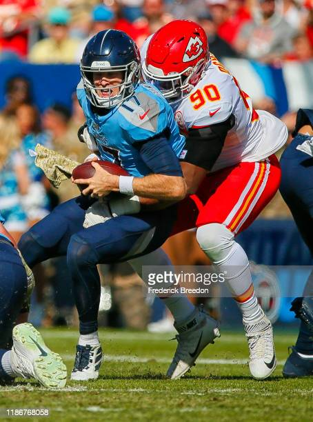 Emmanuel Ogbah of the Kansas City Chiefs sacks quarterback Ryan Tannehill of the Tennessee Titans during the first half at Nissan Stadium on November...