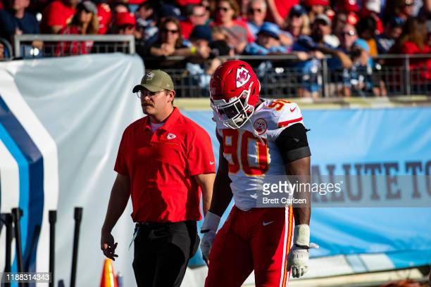 Emmanuel Ogbah of the Kansas City Chiefs walks to locker rooms with trainers during the second half against the Tennessee Titans at Nissan Stadium on...
