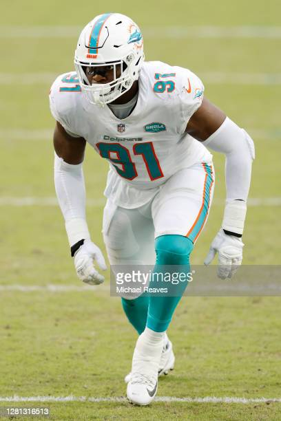 Emmanuel Ogbah of the Miami Dolphins in action against the New York Jets at Hard Rock Stadium on October 18, 2020 in Miami Gardens, Florida.
