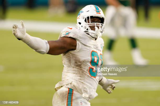 Emmanuel Ogbah of the Miami Dolphins reacts after a sack against the New York Jets at Hard Rock Stadium on October 18, 2020 in Miami Gardens, Florida.