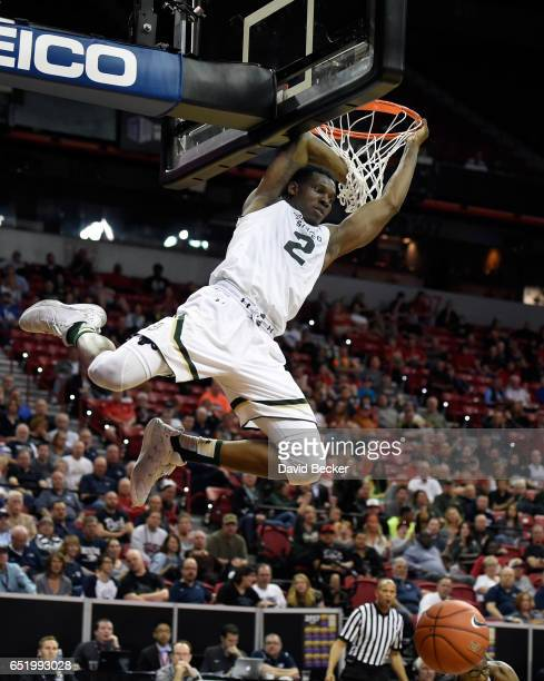 Emmanuel Omogbo of the Colorado State Rams dunks the ball against the San Diego State Aztecs during the first half of a semifinal game of the...