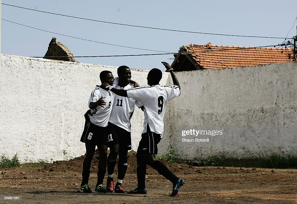Emmanuel Pappde,Sulley Ali Muntari and Frimpeng Asamoah of Ghana celebrate after the first goal during the World Cup Qualifying match between Cape Verde and Ghana at the Varzea Stadium on October 8, 2005 in Praia, Cape Verde.