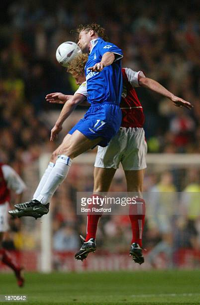 Emmanuel Petit of Chelsea battles with Ray Parlour of Arsenal during the FA Cup Quarter Final Replay match between Chelsea and Arsenal at Stamford...