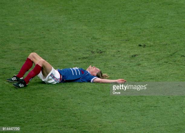 Emmanuel Petit of France celebrates the victory at the end of the game during the Soccer World Cup Final between Brazil and France on July 12 1998 in...