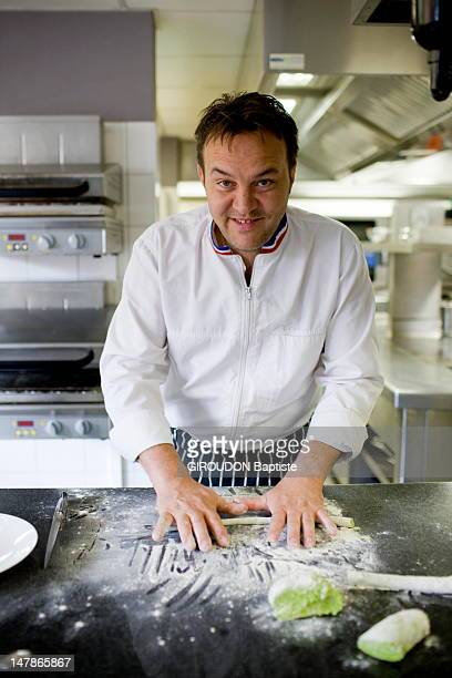 Emmanuel Renaut chef of the three Michelin star restaurant Flocons de Sel works in the kitchen of his restaurant cooking dishes with herbs picked in...