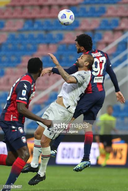 Emmanuel Riviere of Crotone competes for the ball in air with Danilo of Bologna during the Serie A match between FC Crotone and Bologna FC at Stadio...