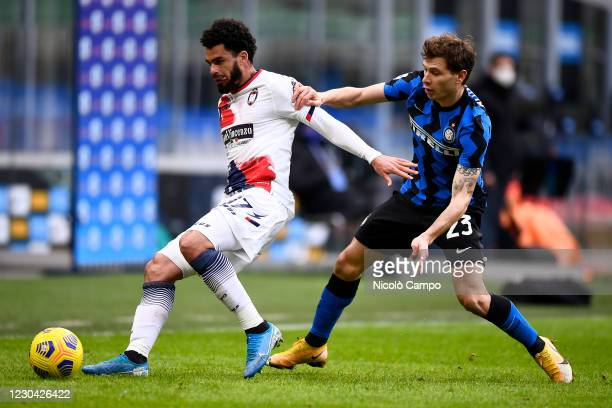 Emmanuel Riviere of FC Crotone is challenged by Nicolo Barella of FC Internazionale during the Serie A football match between FC Internazionale and...