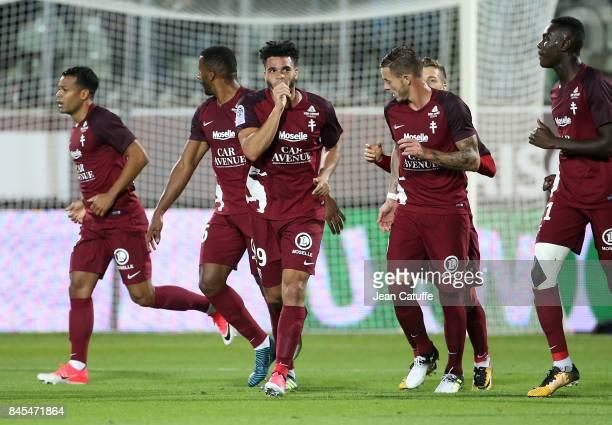 Emmanuel Riviere of FC Metz celebrates his goal during the French Ligue 1 match between FC Metz and Paris Saint Germain at Stade SaintSymphorien on...