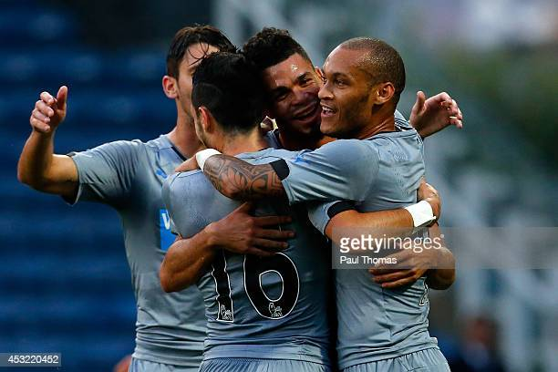 Emmanuel Riviere of Newcastle celebrates his goal with team mates during the Pre Season Friendly match between Huddersfield Town and Newcastle United...