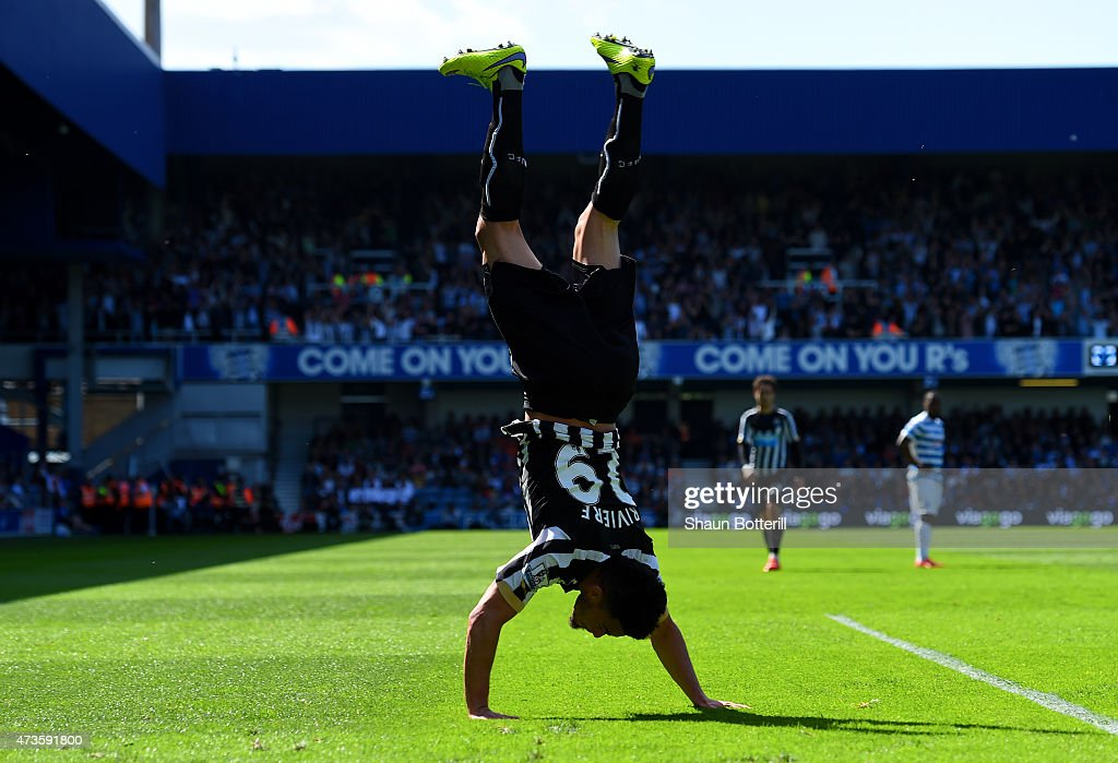 Emmanuel Riviere of Newcastle United celebrates scoring the opening goal during the Barclays Premier League match between Queens Park Rangers and Newcastle United at Loftus Road on May 16, 2015 in London, England.