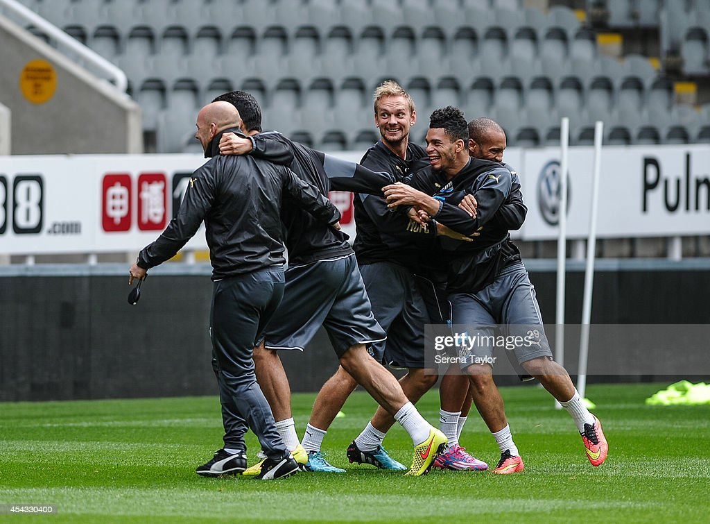 Emmanuel Riviere (R) Yoan Gouffran (hidden) and Siem de Jong laugh with Steven Taylor (2nd right) and First Team Coach Steve Stone (L) during a Newcastle United Training Session at St.James Park on August 29, 2014, in Newcastle upon Tyne, England.