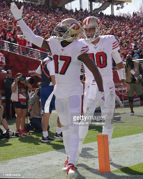 Emmanuel Sanders and Jimmy Garoppolo of the San Francisco 49ers celebrates after Sanders caught a touchdown pass against the Carolina Panthers during...