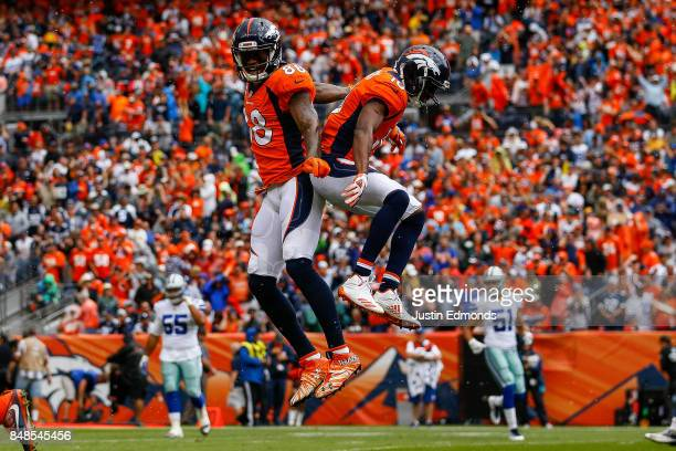 Emmanuel Sanders and wide receiver Demaryius Thomas of the Denver Broncos celebrate after a first quarter touchdown against the Dallas Cowboys at...