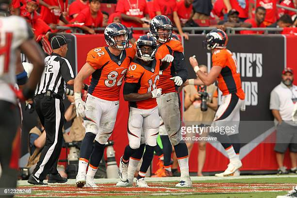 Emmanuel Sanders of the Broncos makes catches Paxton Lynch's first career touchdown pass and celebrates in the end zone with team mates during the...