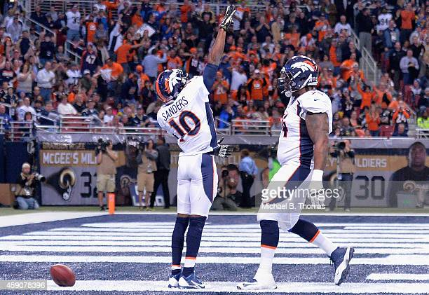 Emmanuel Sanders of the Denver Broncos celebrates after scoring a 42yard touchdown against the St Louis Rams in the second quarter at the Edward...
