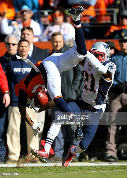 Emmanuel Sanders of the Denver Broncos is tackled by Malcolm Butler of the New England Patriots in the first quarter in the AFC Championship game at...