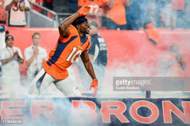 Emmanuel Sanders of the Denver Broncos runs onto the field during player introductions before a game against the Kansas City Chiefs at Empower Field...