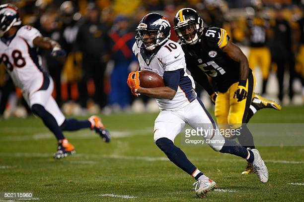 Emmanuel Sanders of the Denver Broncos runs the ball past Sean Spence of the Pittsburgh Steelers during the first half of the game at Heinz Field on...