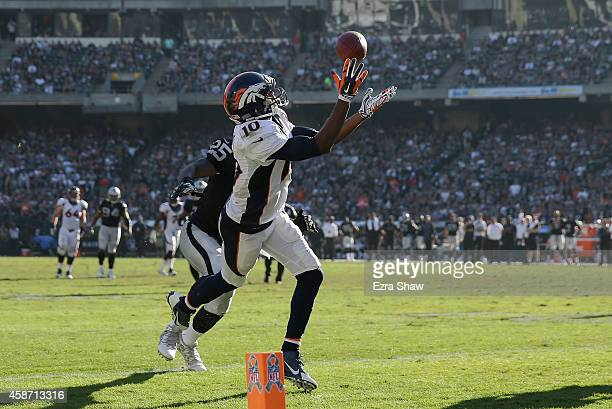 Emmanuel Sanders of the Denver Broncos scores a touchdown at the end of the first half against the Oakland Raiders at Oco Coliseum on November 9 2014...
