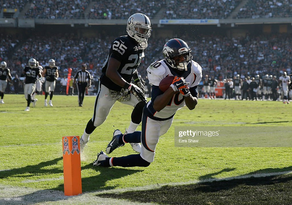Emmanuel Sanders #10 of the Denver Broncos scores a touchdown at the end of the first half against the Oakland Raiders at O.co Coliseum on November 9, 2014 in Oakland, California.