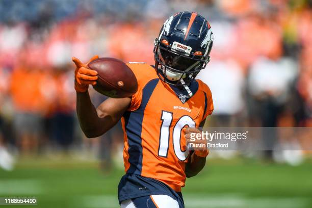 Emmanuel Sanders of the Denver Broncos stands on the field as he warms up before a game against the Chicago Bears at Empower Field at Mile High on...