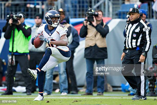 Emmanuel Sanders of the Denver Broncos throws the ball against the backdrop after scoring a touchdown and is called for unsportsmanlike conduct...