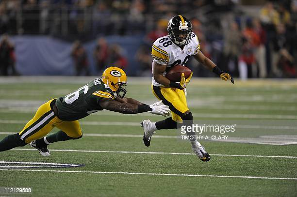 Emmanuel Sanders of the Pittsburgh Steelers is challenged by Charlie Peprah of the Green Bay Packers during the NFL Super Bowl XLV football game on...