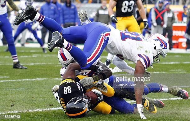 Emmanuel Sanders of the Pittsburgh Steelers is tackled by Jairus Byrd of the Buffalo Bills during the game on November 10 2013 at Heinz Field in...