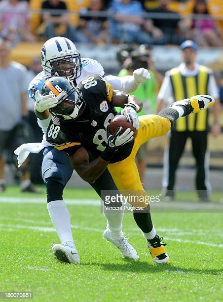 Emmanuel Sanders of the Pittsburgh Steelers makes a diving catch against the Tennessee Titans during the fourth quarter at Heinz Field on September 8...