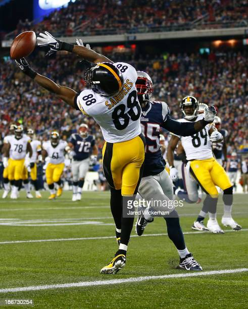 Emmanuel Sanders of the Pittsburgh Steelers misses an attempted pass in the endzone in front of Kyle Arrington of the New England Patriots in the...