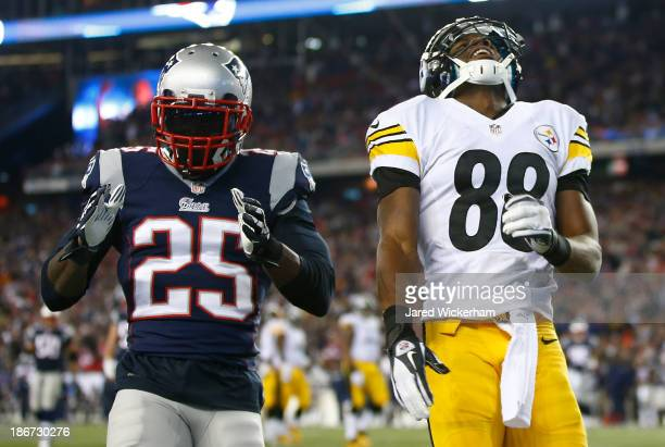 Emmanuel Sanders of the Pittsburgh Steelers reacts after missing an attempted catch in the endzone next to of Kyle Arrington of the New England...
