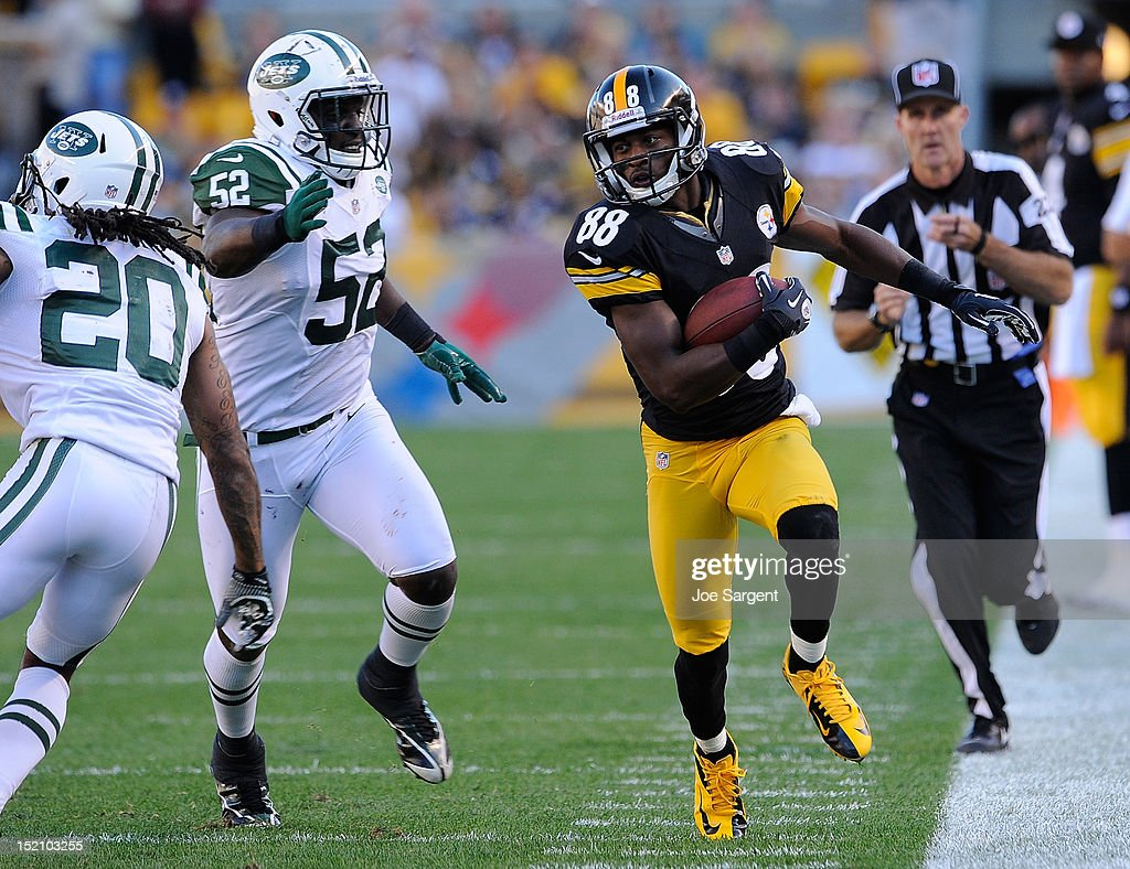Emmanuel Sanders #88 of the Pittsburgh Steelers runs after the catch in front of David Harris #52 of the New York Jets on September 16, 2012 at Heinz Field in Pittsburgh, Pennsylvania.