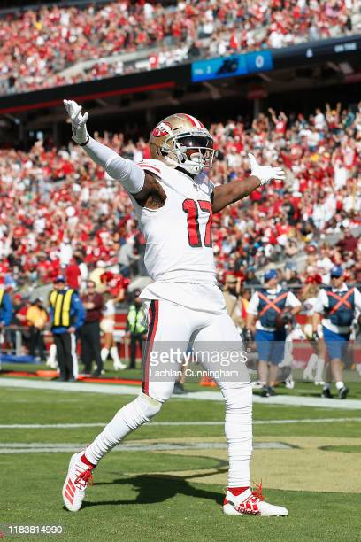 Emmanuel Sanders of the San Francisco 49ers celebrates after catching a touchdown pass in the first quarter against the Carolina Panthers at Levi's...