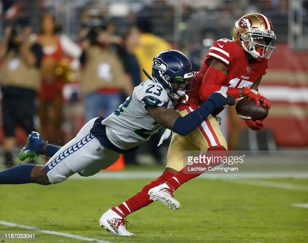 Emmanuel Sanders of the San Francisco 49ers is tackled by Neiko Thorpe of the Seattle Seahawks in the first quarter at Levi's Stadium on November 11...