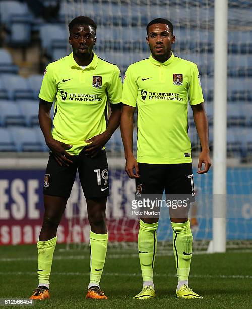 Emmanuel Sonupe and Kenji Gorre of Northampton Town line up to defend a free kick during the EFL Checkatrade Trophy match between Coventry City and...