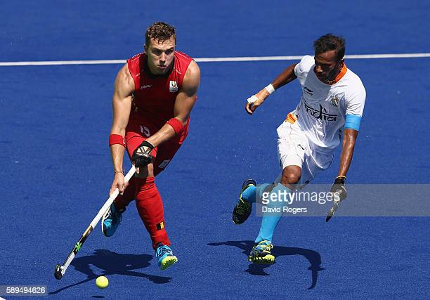 Emmanuel Stockbroekx of Belgium moves away from Akashdeep Singh during the Men's hockey quarter final match between Belgium and India on Day 9 of the...
