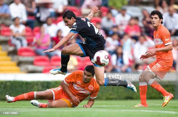 Emmanuel Tapia of Queretaro and Juan de la Barrera of Correcaminos UAT fight for the ball during a match between Queretaro and Correcaminos as part...