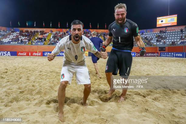 Emmanuele Zurlo and goalkeeper Simone Del Mestre of Italy celebrate the victory after the FIFA Beach Soccer World Cup Paraguay 2019 quarter final...
