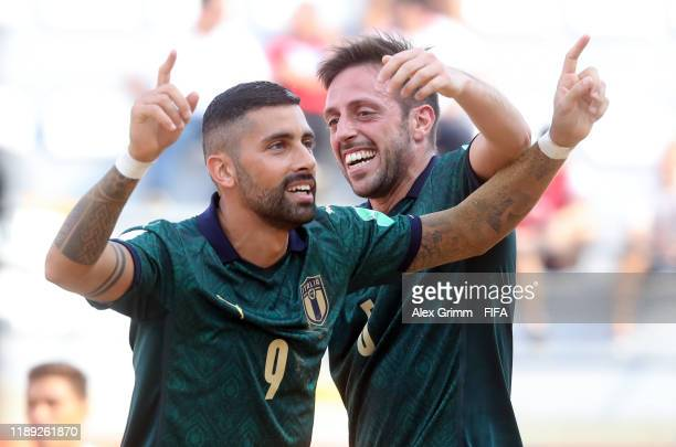 Emmanuele Zurlo of Italy celebrates a goal with team mate Alessio Frainetti during the FIFA Beach Soccer World Cup Paraguay 2019 group B match...