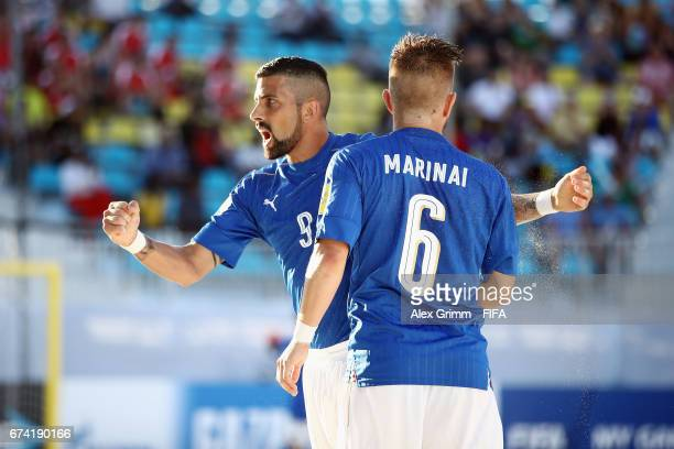 Emmanuele Zurlo of Italy celebrates a goal with team mate Simone Marinai during the FIFA Beach Soccer World Cup Bahamas 2017 group B match between...