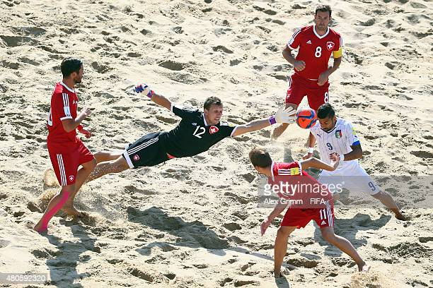 Emmanuele Zurlo of Italy scores a goal against goalkeeper Valentin Jaeggy during the FIFA Beach Soccer World Cup Portugal 2015 Group B match beween...