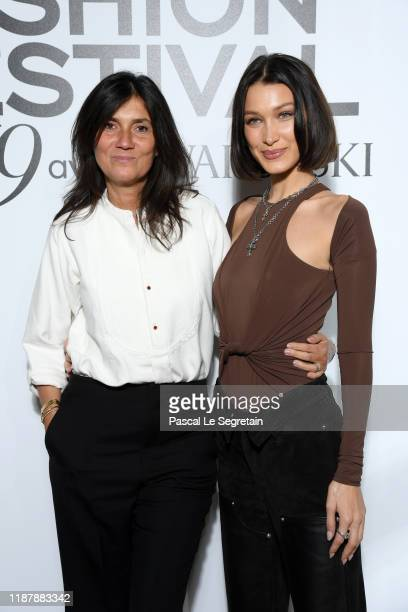 Emmanuelle Alt and Bella Hadid attend Vogue Fashion Festival Photocall At Hotel Potocki In Paris on November 15 2019 in Paris France