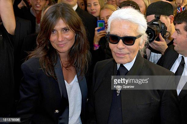 Emmanuelle Alt and Karl Lagerfeld attend Vogue Fashion Night Out 2012 on September 6 2012 in Paris France