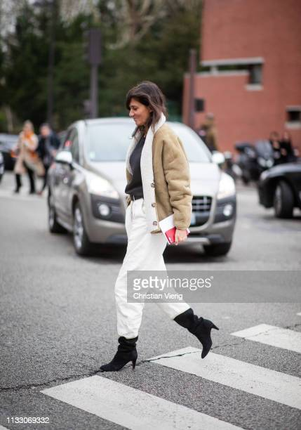 Emmanuelle Alt is seen wearing shearling jacket white pants outside Nina Ricci during Paris Fashion Week Womenswear Fall/Winter 2019/2020 on March 01...