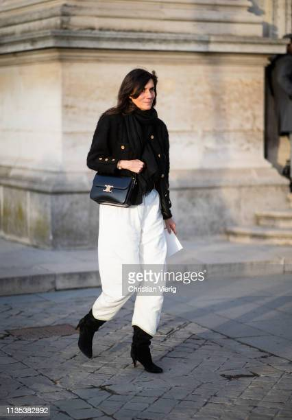 Emmanuelle Alt is seen wearing white pants outside Louis Vuitton during Paris Fashion Week Womenswear Fall/Winter 2019/2020 on March 05 2019 in Paris...