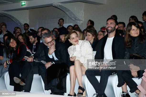 Emmanuelle Alt Owners of Gaultier Manuel Puig his brother Marc Puig Marion Cotillard and Nicolas Ghesquiere attend the JeanPaul Gaultier Haute...